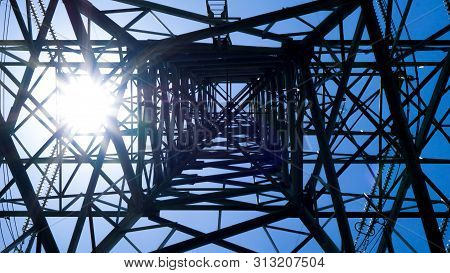 Electric Pole And Electricity Energy Concept - Silhouette Of High Voltage Electric Pole With Blue Sk