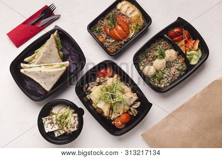 Healthy Food In Black Boxes With Daily Ration Preparing For Delivery