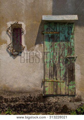 A door in a derelict stone house in the small historic hill village of Drenchia Inferiore in Friuli-Venezia Giulia, north east Italy poster