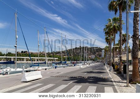 Malaga, Spain - May 24, 2019: View Of A Road And Yachts At The Paseo Del Muelle Uno, A Beachfront Sh