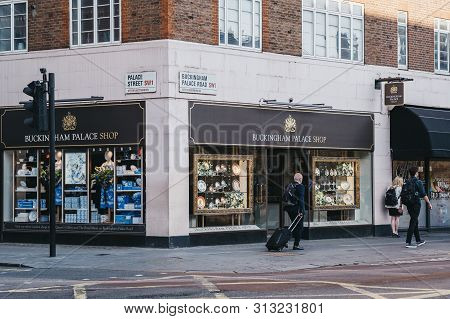 London, Uk - July 15, 2019: Tourists Walking Past Buckingham Palace Shop, London, A Royal Shop For G