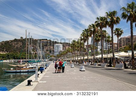 Malaga, Spain - May 24, 2019: Yachts And People At The Paseo Del Muelle Uno, A Beachfront Shopping A