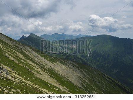 View From Banikov Peak On Western Tatra Mountains Ridge Or Rohace Panorama. Sharp Green Mountains -