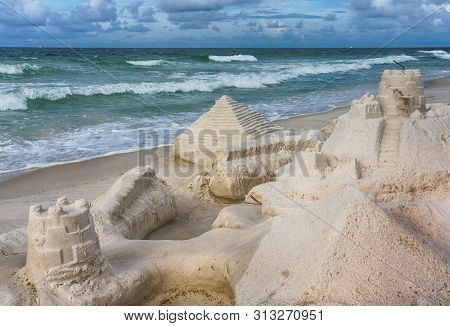 Detailed Sand Castle At Pensacola Beach On The Gulf Of Mexico With Surf And Stormy Weather Backgroun