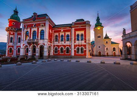 Ruzomberok, Slovakia - April 26, 2019: Town Hall And A Church In The Main Square Of Ruzomberok.
