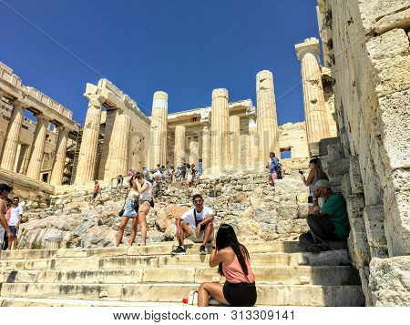 Athens, Greece - July 12th, 2019: A Group Of Tourists Enter And Take Pictures At The Entrance Of The