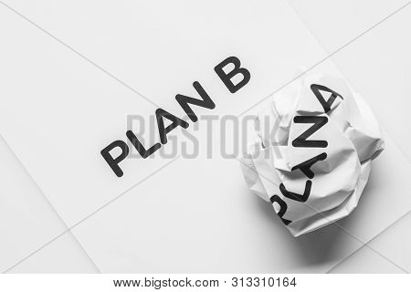 Crumpled Paper Plan A And Clean Sheet Paper Plan B On White Background. Change The Idea From Plan A