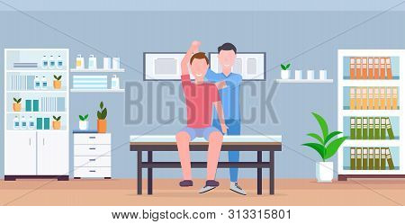 Man Patient Sitting On Table Masseur Therapist Doing Healing Treatment Massaging Patient Body Manual