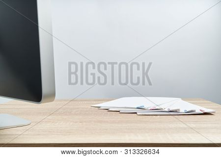 Busy Paperwork Report And Computer On Wooden Table