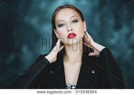 A portrait of a beautiful young woman. Beauty, cosmetics, evening makeup.