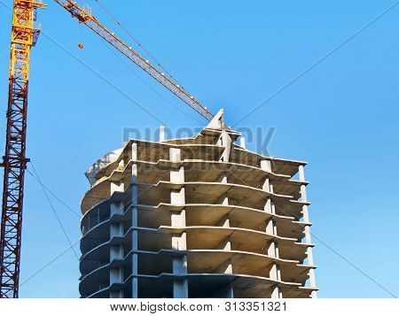 Construction Of A Multi-storey Hotel Complex. Construction Site Background. Crane And Building Under