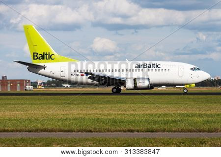 Amsterdam / Netherlands - August 14, 2014: Air Baltic Boeing 737-500 Yl-bbe Passenger Plane Landing