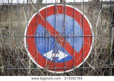 German No Parking Traffic Sign, Behind A Metal Fence