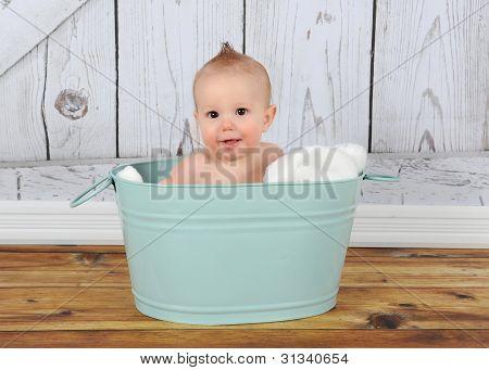 Happy Baby Sitting In Washtub