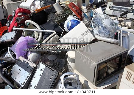 Piles of home electronics for recycling ecology poster