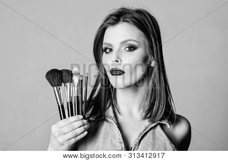 Makeup Cosmetics Concept. Skin Tone Concealer. Cosmetics Shop. Girl Apply Eye Shadows. Woman Applyin