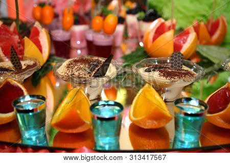 Sweet Buffet Of Fruits And Berries. Fruit Receptions At The Wedding. Delicious And Tasty Dessert Tab