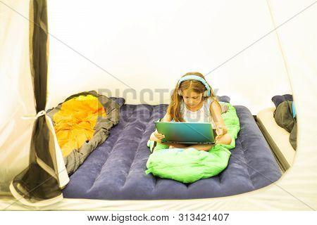 Little Caucasian Girl With Notebook In The Tent