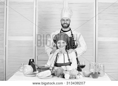 Cooking with your spouse can strengthen relationships. Woman and bearded man culinary partners. Ultimate cooking challenge. Couple compete in culinary arts. Reasons why couples cooking together poster