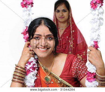 Traditionally Dressed Indian Girls Enjoying On Festivals.