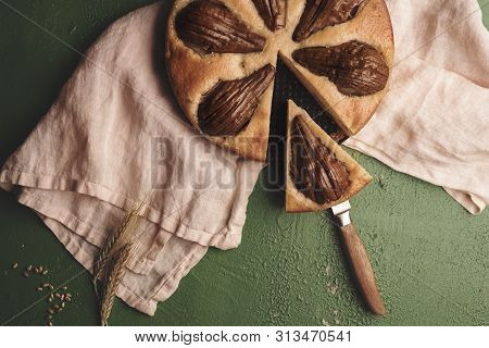 Soft Cake With Whole Pears On A Kitchen Towel. Above View With A Sliced Fruit Pie. Single Slice Of F