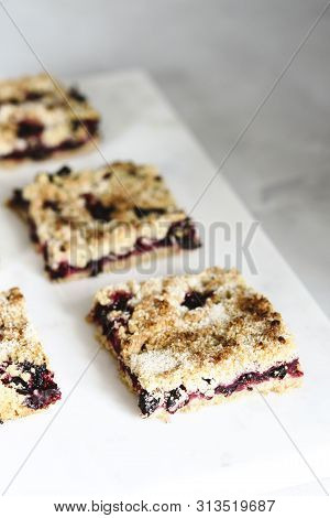 Honeysuckle Crumble Cake Sliced Into Pieces On Grey Marble Tray. Homemade Streusel Berries Pie.  Sel