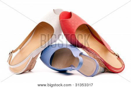 Three open-toe women shoes against white