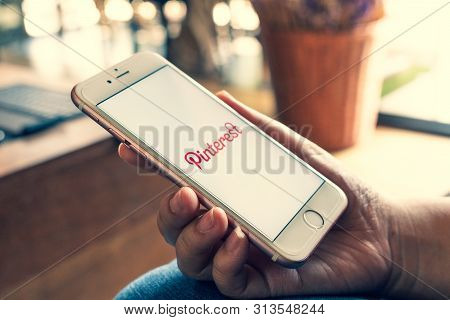 Chiang Mai, Thailand - Apr.27,2019: Woman Holding Apple Iphone 6s Rose Gold With Pinterest Apps On S