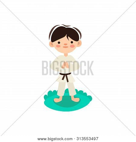 Little Kid, Child Preparing For Karate Training. Boy Doing Martial Fight Exercise On Green Grass. Is
