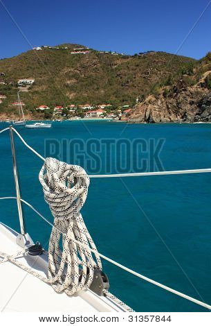 Nautical rope hanging on the sailboat.