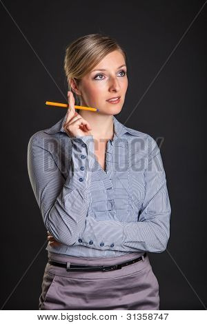 Businesswoman has ideas on gray background