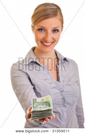 Businesswoman with polish zloty banknotes isolated on white