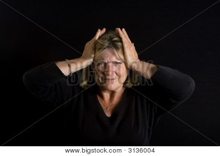 Senior Lady - Hands On Head