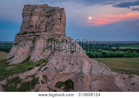 full moon rise over Jail Rock on Nebraska Panhandle