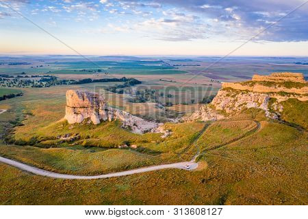 Courthouse and Jail Rocks in Nebraska Panhandle - aerial view ar summer sunrise