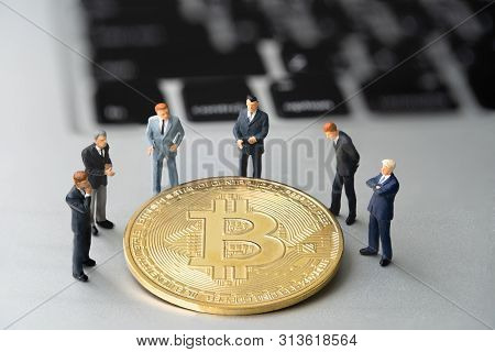 Bitcoin (btc) Coin And Businessmans On Notebook. Digital Cyber Safety Or Security Encryption. Manage