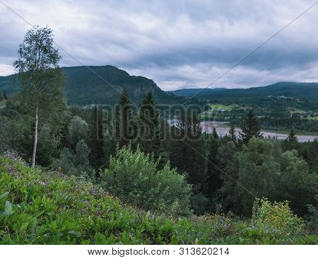 Scenic Evening View Of Kvisloyra Island. It Is Located On The Namsen River In Grong Municipality, Tr