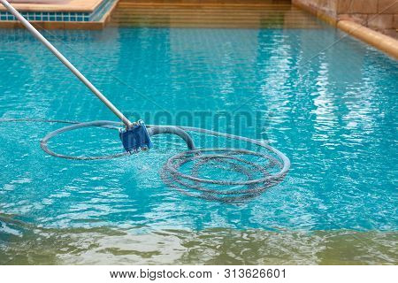Pool Vacuum Cleaning Dirty In Bottom Of Swimming Pool.