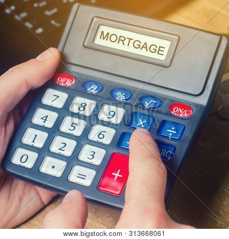 Inscription Mortgage On The Calculator. The Concept Of Calculating Interest On A Mortgage Loan. Mort