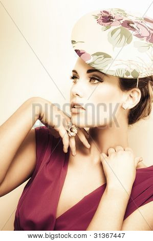 Woman Wearing V-neck Blouse And Floral Hat