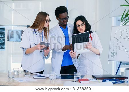 Professional Team Of Multiracial Medical Doctors Having A Conference. Multi Ethnic Group Of Medical