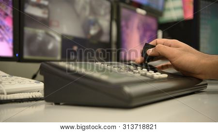 The Hands Of The Officers Are Controlling The Keys Of The Cctv Camera.