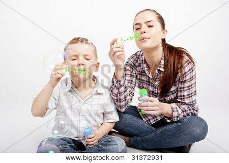 boy, woman and soap bubbles