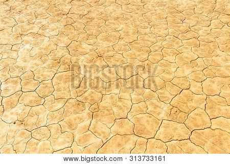 Desiccated Soil. Cracked Dry Earth Texture. Close Up.