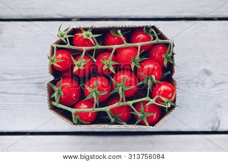 Box Of Fresh Ripe Red Cherry Cocktail Tomatoes Type For Sale In A Market. Vintage Retro Style Pictur