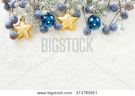 Blue, Golden And Silver Christmas Border. Xmas Composition With Snowy Green Fir Branch, Gold Stars,