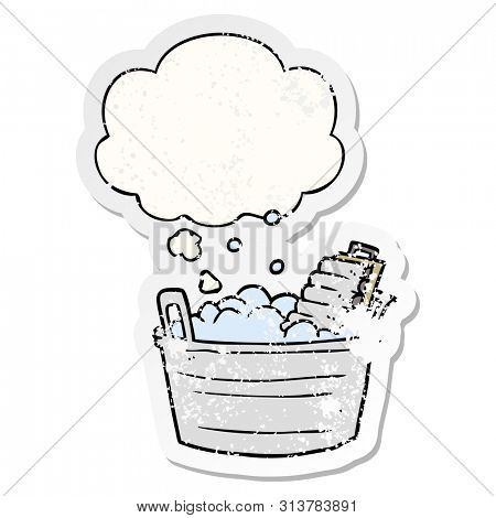 cartoon old washboard and bucket with thought bubble as a distressed worn sticker
