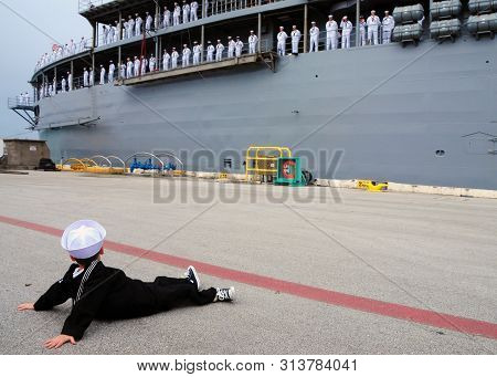 A Little Boy Watches As A Large Steamer With Sailors Swims Away And Dreams Of Sailing As Well Someda