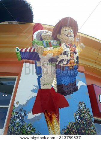 California - July 23, 2012: Lego Toy Story Characters Buzz Lightyear And Woody Blasting Off In Displ