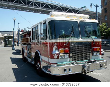 San Francisco, California - June 28, 2009: Sffd Red Firetruck Parked On Street With Sun Reflecting I